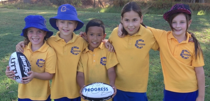 Group of kindy kids take a photo together with footballs