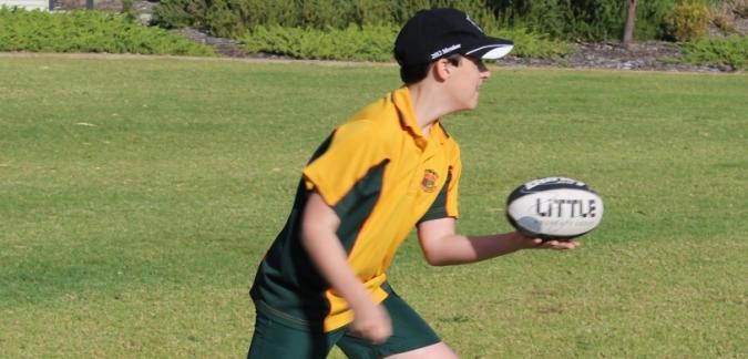 Primary school boy playing football