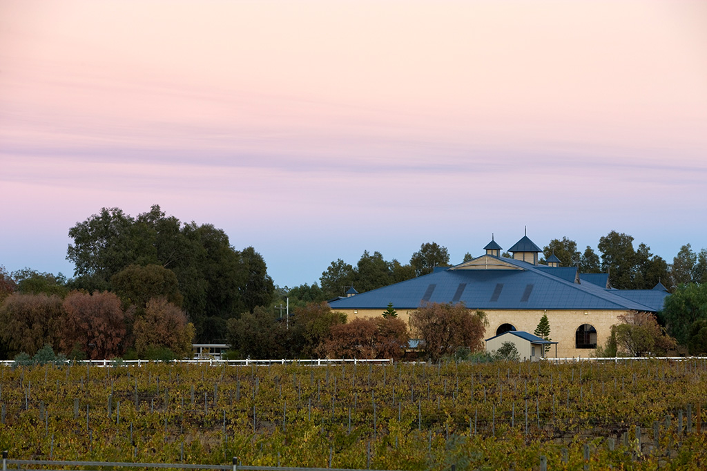 vineyards and limestone building